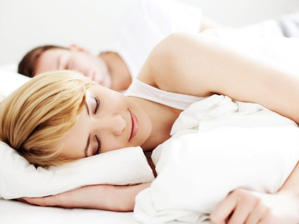 Man and girl restfully sleeping.